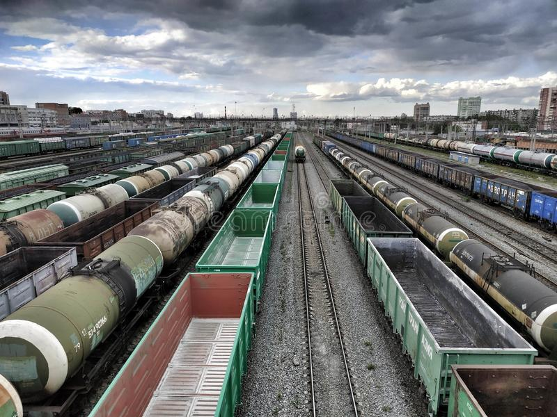 Cargo and passenger wagons. On train station in city, aerial view stock images