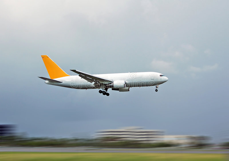Cargo plane landing stock photos