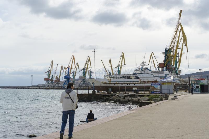 Cargo port of Feodosia with cranes and ships. View from from the city promenade. Feodosia, Crimea stock photo