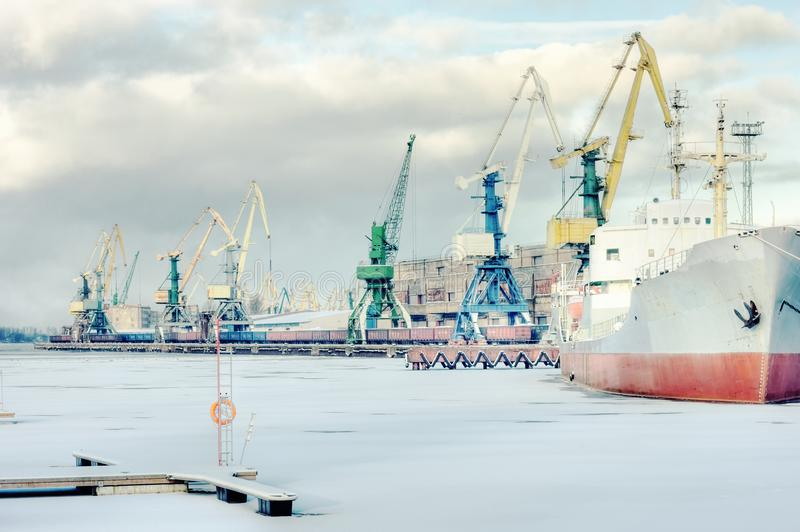 Cargo port on a frozen river stock photo