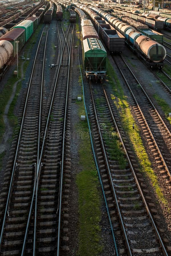 Cargo railway transportation industry. Railway yard from top view. Vertical orientation royalty free stock photography
