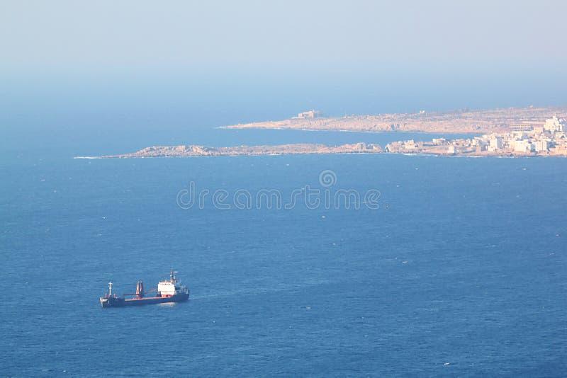 Blue Cargo Ship at Chekka Harbor in Lebanon royalty free stock photos