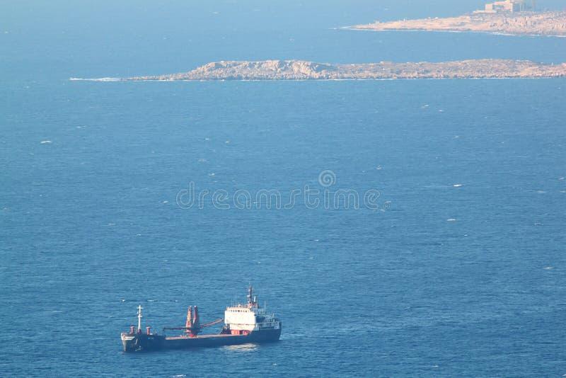 Blue Cargo Ship at Chekka Harbor in Lebanon royalty free stock image