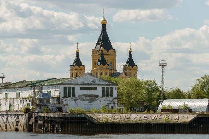 Cargo river port and Alexander Nevsky Cathedral on the Strelka. Nizhny Novgorod royalty free stock photos