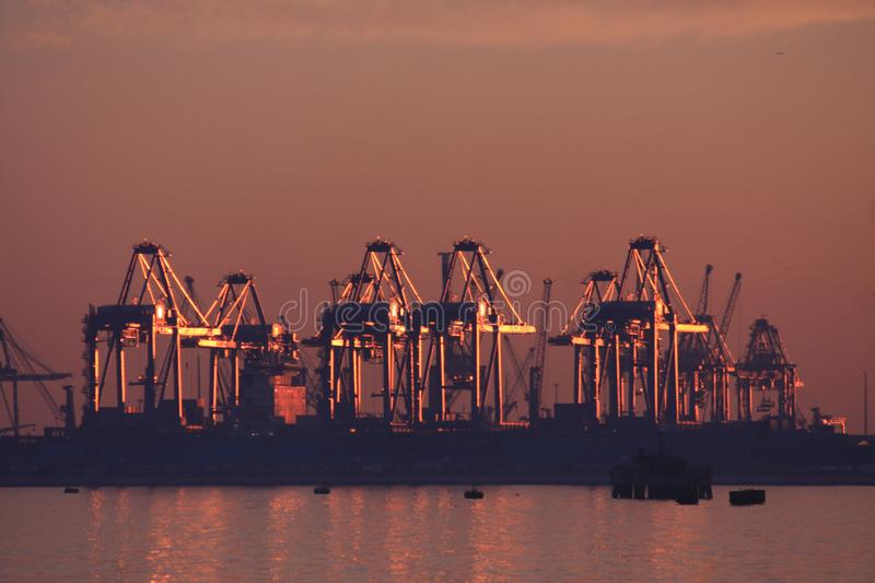 Cargo sea port at sunset. Sea Port with sunset royalty free stock image