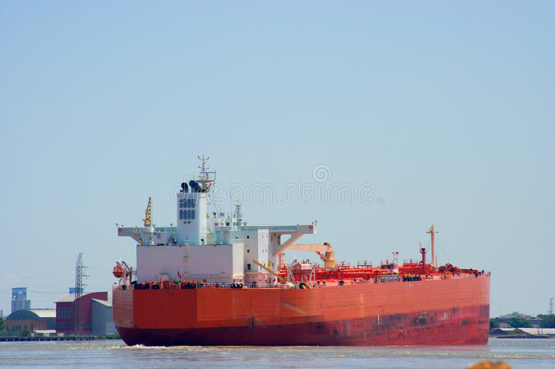 Cargo ship. Sailing down a large river royalty free stock image