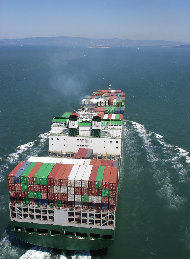 Cargo Ship. With containers passing under the Golden Gate bridge in San Francisco