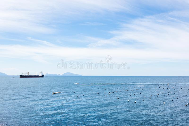 Cargo ship in the blue sea. royalty free stock photography
