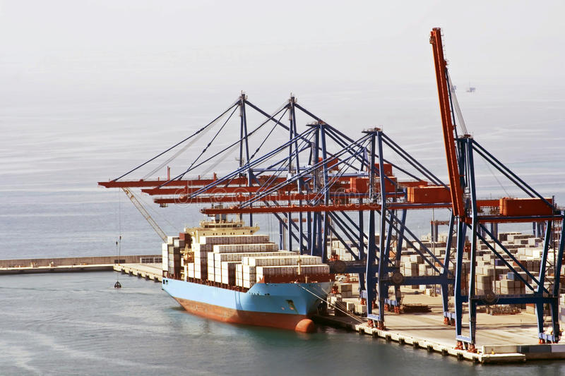 Cargo Ship In A Port With Cranes Loading Stock Images