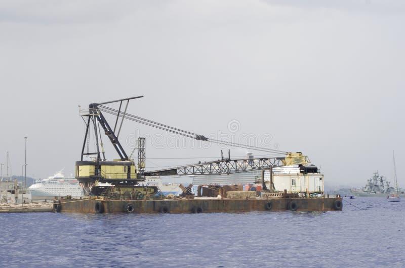 Cargo ship docking stock photos