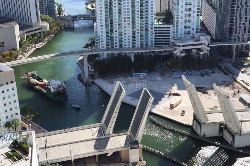 Cargo ship entering the Miami River in Downtown Miami. A divorced bridge. Passage of a cargo ship under the bridge. Taken from the. Air stock image