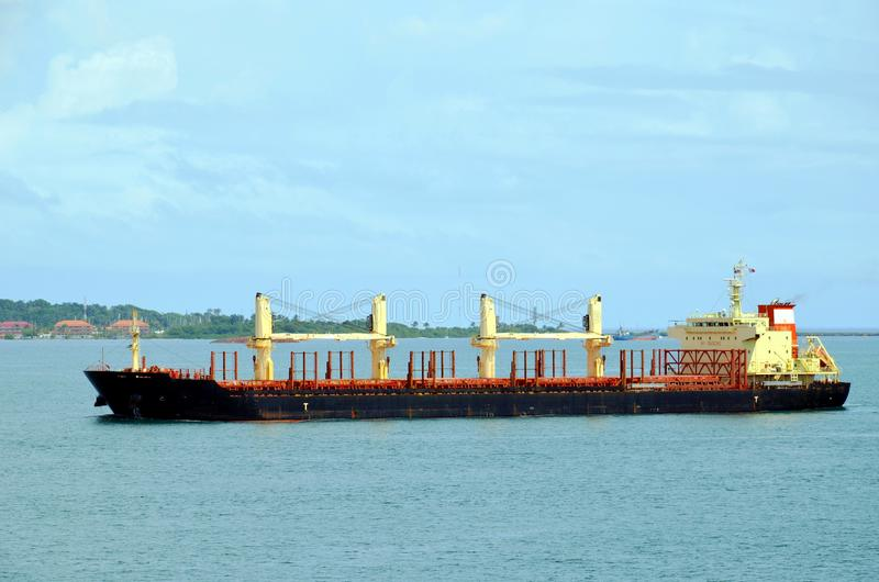 Cargo ship entering Panama Canal in the Cristobal, Panama royalty free stock photo