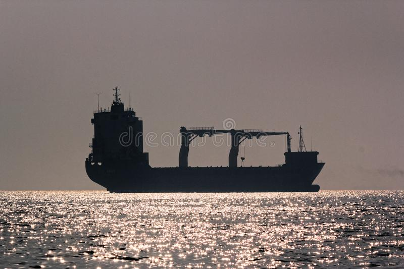Cargo Ship on high seas. Silhouette of a large Cargo Ship on the high seas in Mumbai, India stock photo