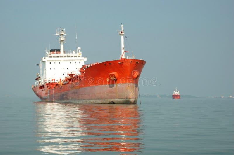 Cargo ship in Indian ocean stock photos