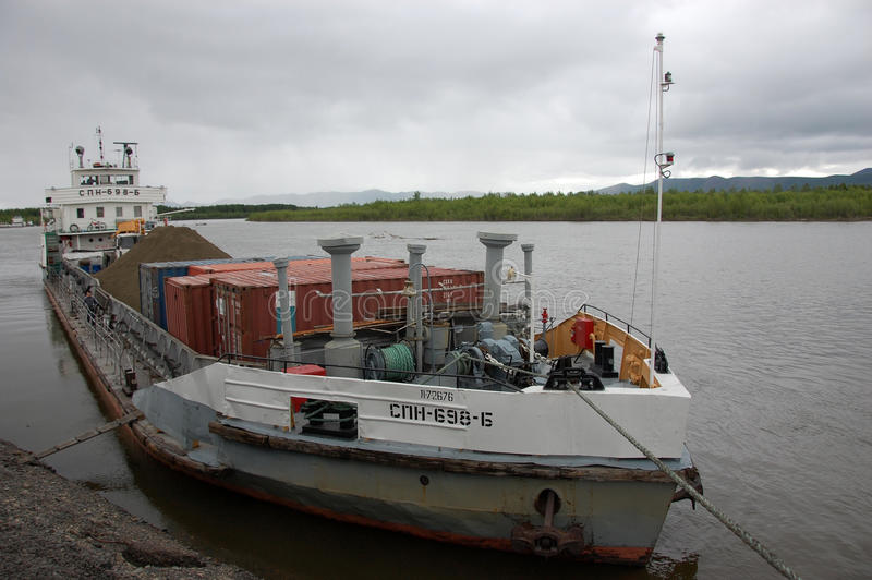 Cargo ship at Kolyma river port Russia outback stock images