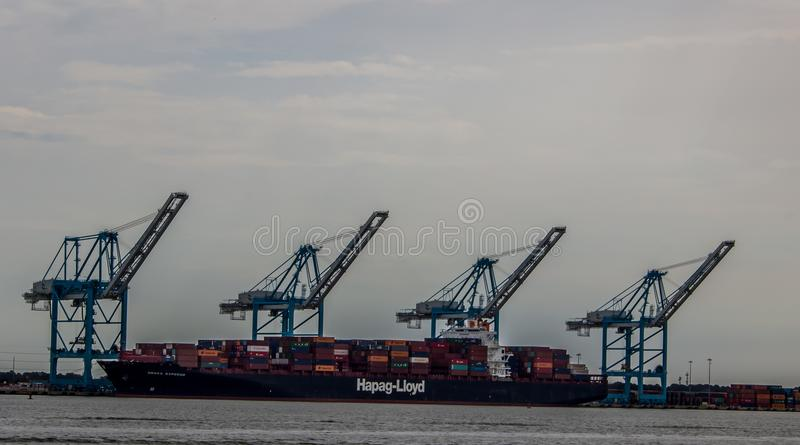 Cargo ship loaded in front of derricks in Norfolk Virginia royalty free stock images