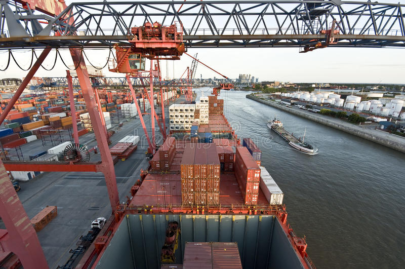 Cargo ship loading containers in Rotterdam. royalty free stock photo