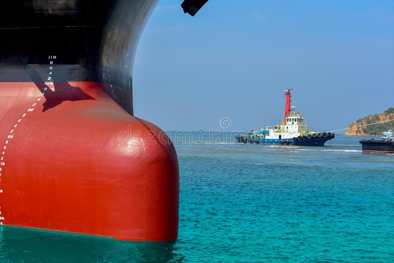Cargo ship Moored and Mooring bollard with a fixed rope on the front of Bulbous bow ship Logistics and Transportation. Cargo ship Moored and Mooring bollard stock photo