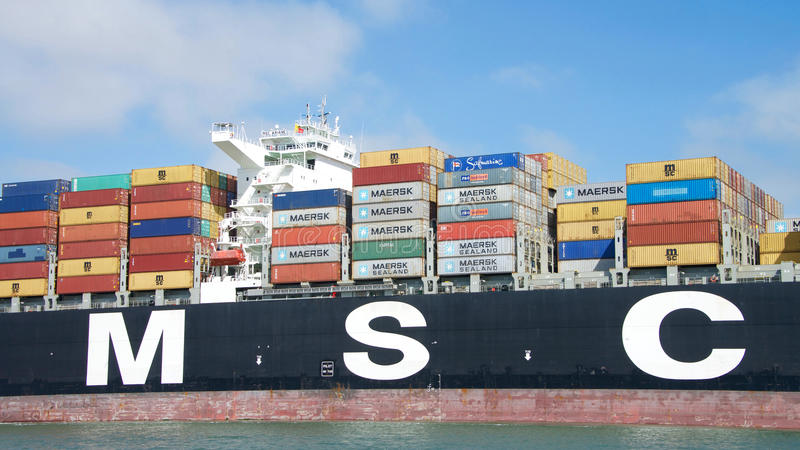 Cargo Ship MSC ARIANE entering the Port of Oakland. Oakland, CA - September 12, 2016: Cargo Ship MSC ARIANE with thousands of shipping containers organized and royalty free stock photo