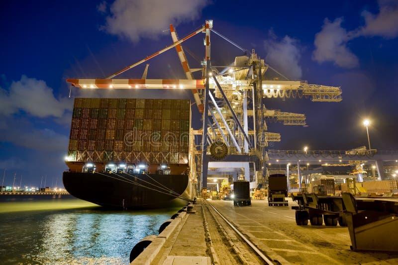 Cargo ship by night royalty free stock photos