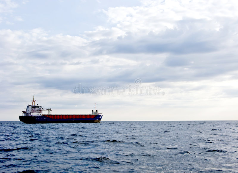 Download Cargo ship in ocean stock image. Image of transport, clouds - 5564875