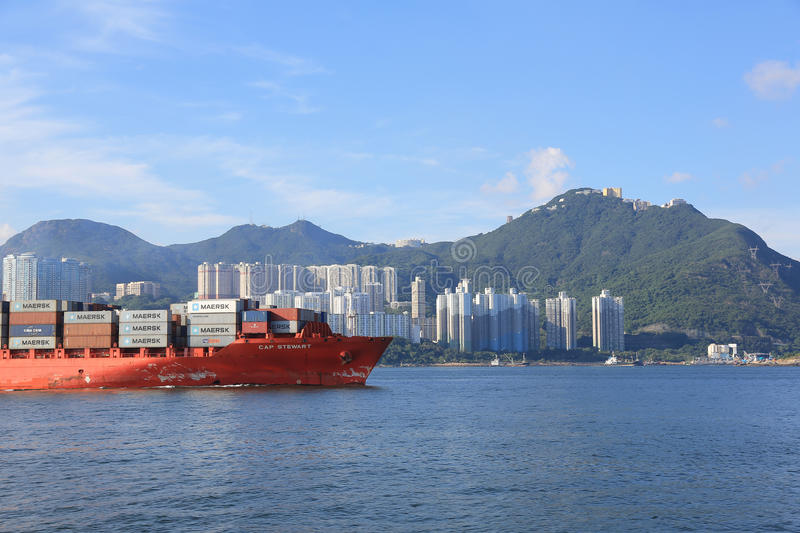 Cargo ship passing the East Lamma Channel. Hk royalty free stock photo