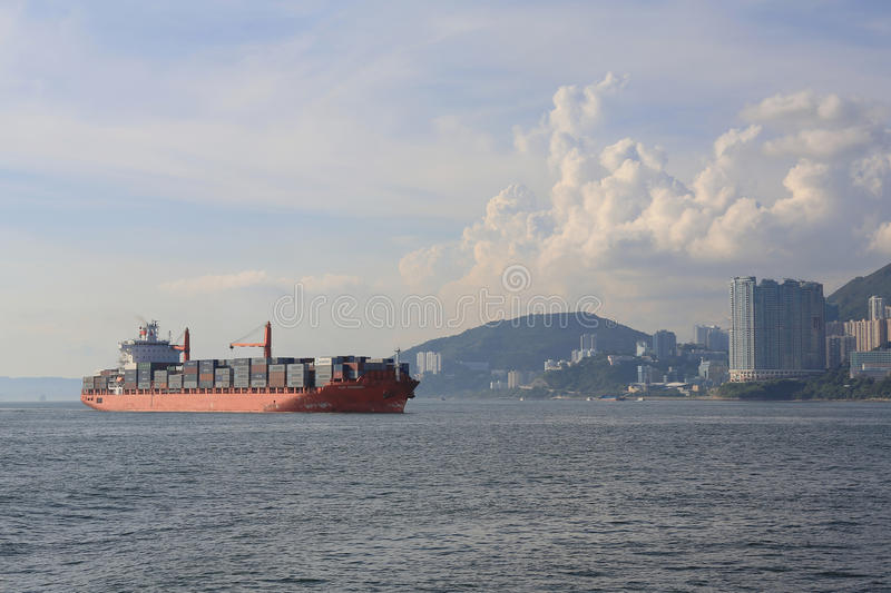 Cargo ship passing the East Lamma Channel. Hk stock images