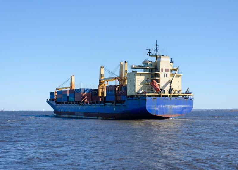 Cargo ship sailing in still water stock photos