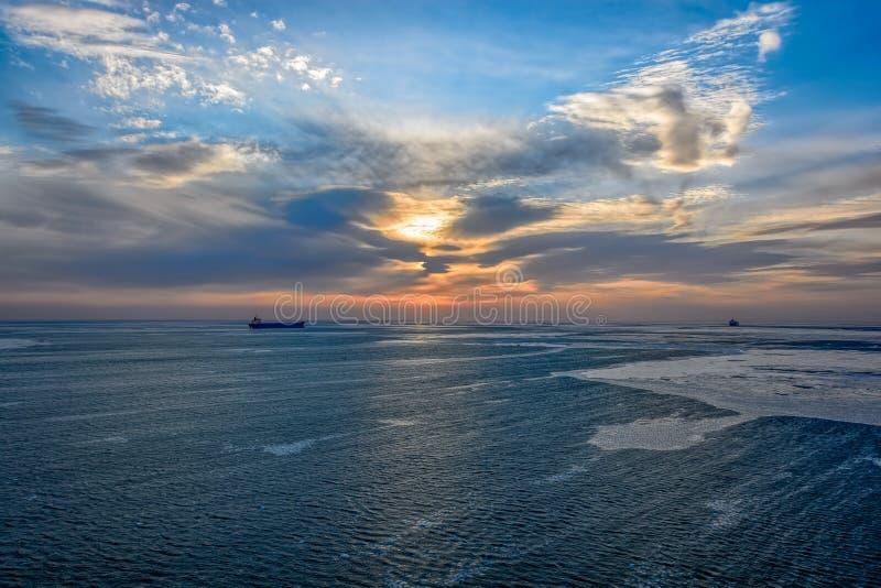 Cargo ship sailing on sunrise royalty free stock photos