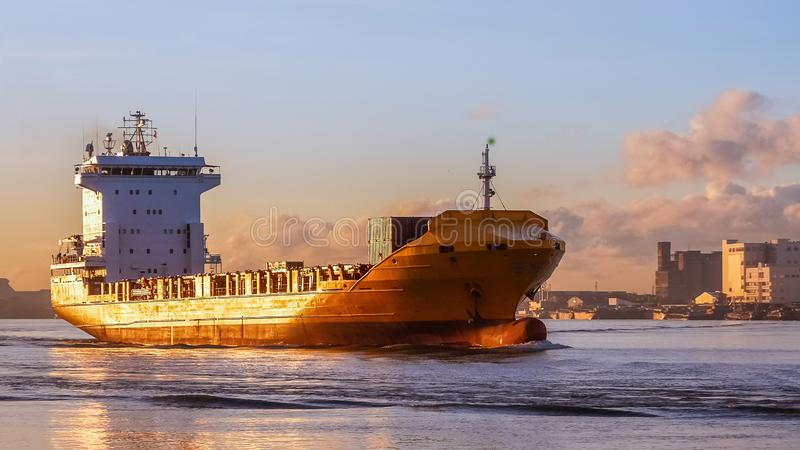 Cargo ship is sailing to sea to transport cargo in containers.Logistics and transportation of International. Freight Transportation, Shipping royalty free stock photo
