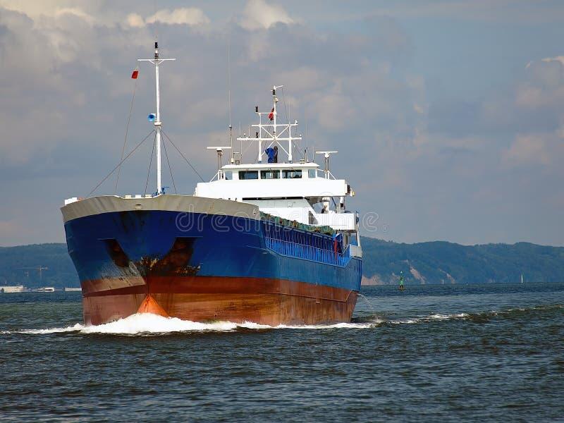 Cargo ship at sea royalty free stock images