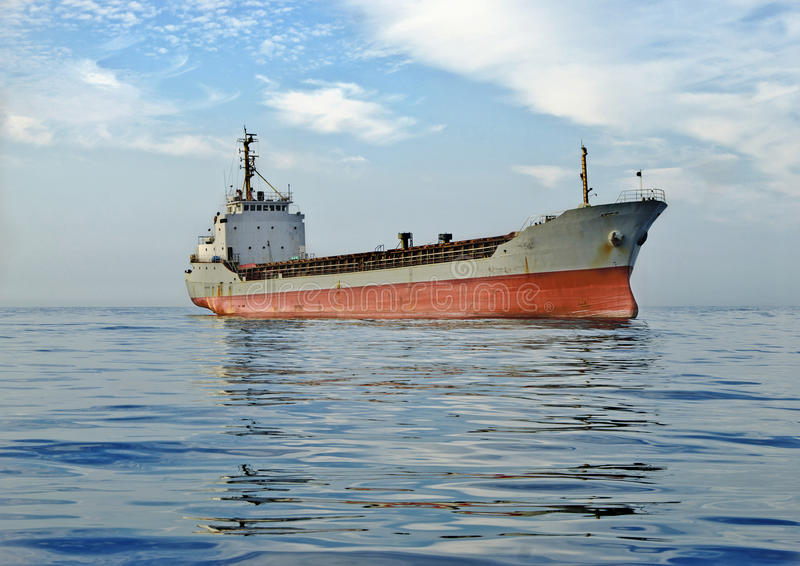 Cargo ship at sea stock image