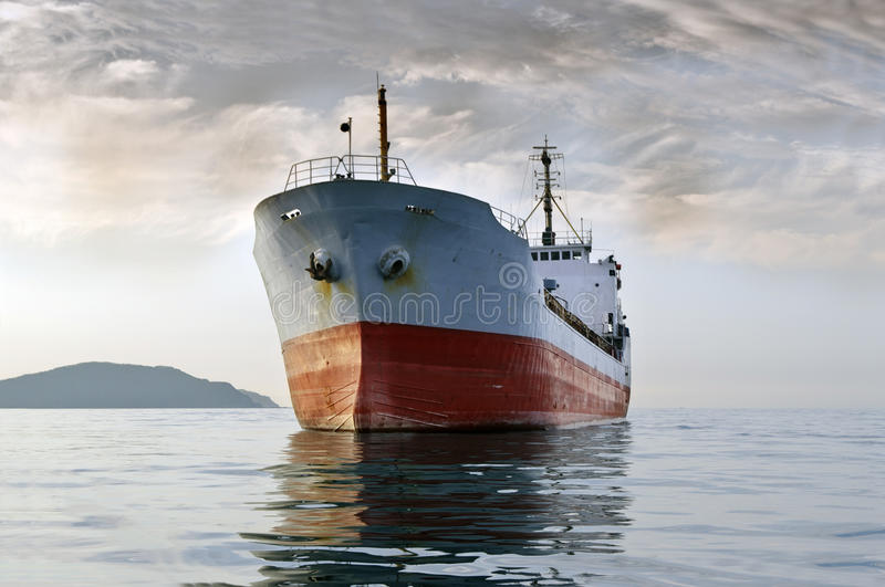 Cargo ship at sea stock photography
