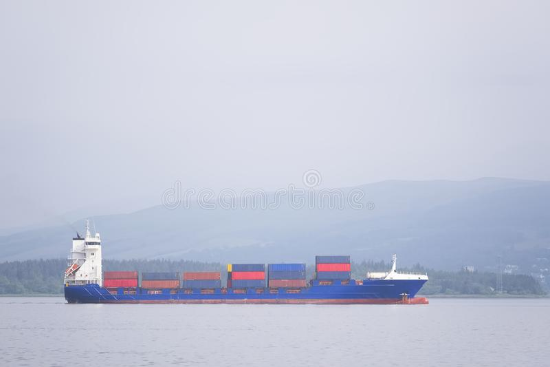 Cargo ship vessel freight containers carrier transport on sea ocean to port dock. Uk stock photos