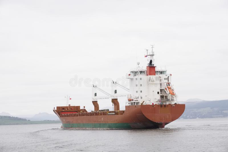 Cargo ship vessel freight containers carrier transport on sea ocean to port dock. Uk stock photography