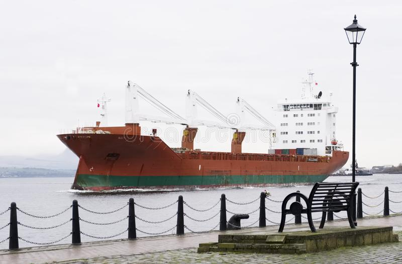 Cargo ship vessel freight containers carrier transport on sea ocean to port dock. Uk royalty free stock images