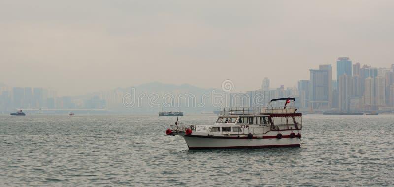 A cargo ship in Victoria Harbor of Hong Kong royalty free stock photos
