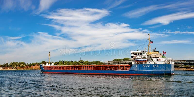 Cargo ship on the way royalty free stock photo