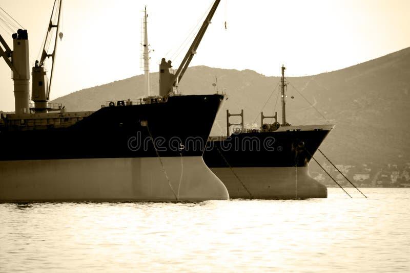 Cargo ships bows stock photos