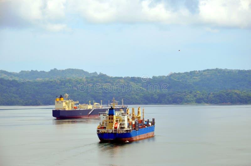 Cargo ships transiting Panama Canal. Cargo ships on the Gatun Lake during Panama Canal transit stock images