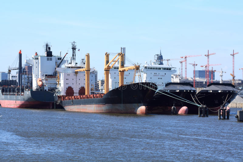 Cargo ships in harbour royalty free stock image