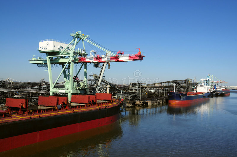 Cargo ships at oil refinery stock photo