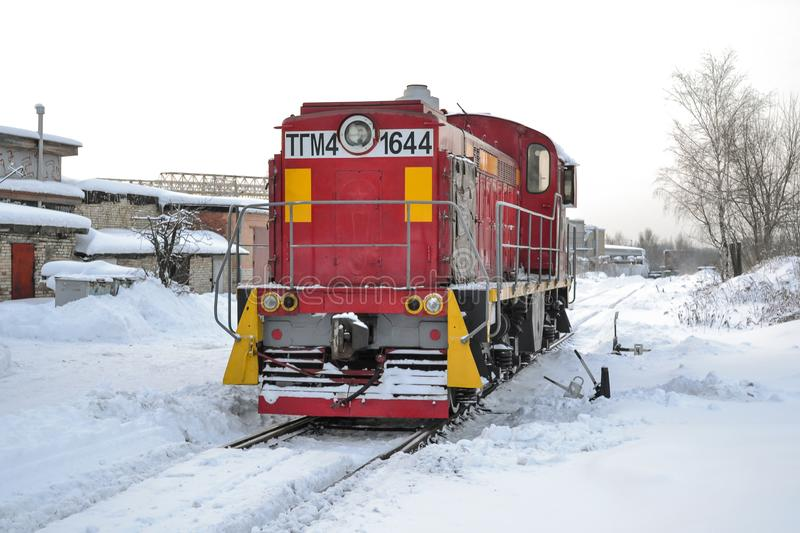 Cargo shunting locomotive of red color in winter. Locomotive in the snow. Russia. Cargo shunting locomotive of red color in winter. Locomotive in the snow royalty free stock image