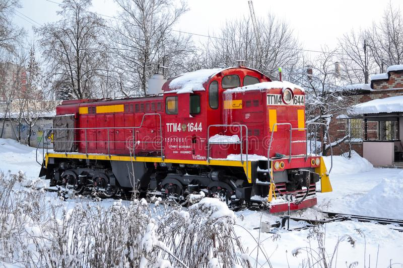 Cargo shunting locomotive of red color in winter. Locomotive in the snow. Russia. Cargo shunting locomotive of red color in winter. Locomotive in the snow royalty free stock photography