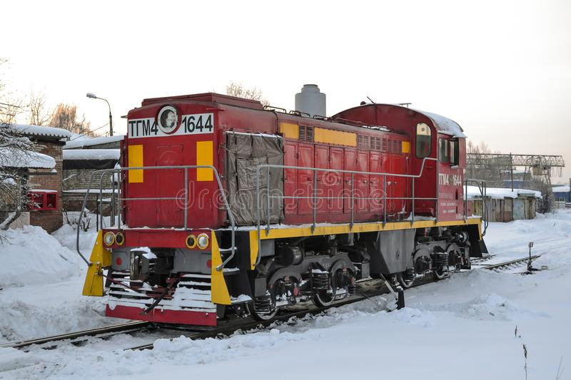 Cargo shunting locomotive of red color in winter. Locomotive in the snow. Russia. Cargo shunting locomotive of red color in winter. Locomotive in the snow stock photography
