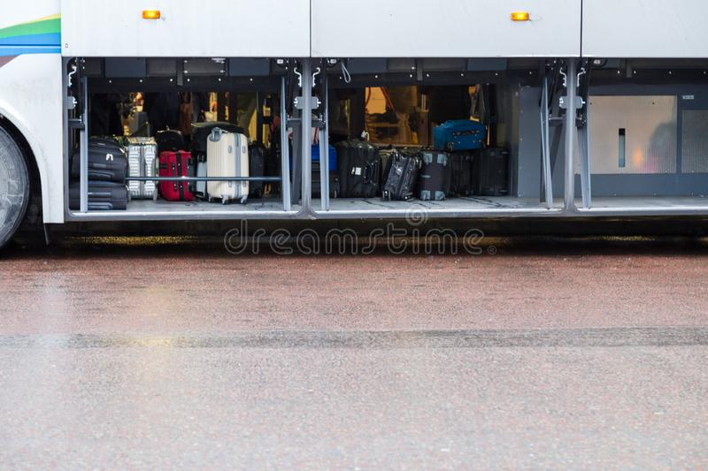 Cargo space of a bus with passengers luggage and bags. Cargo space of a bus with passengers luggage and big bags royalty free stock image