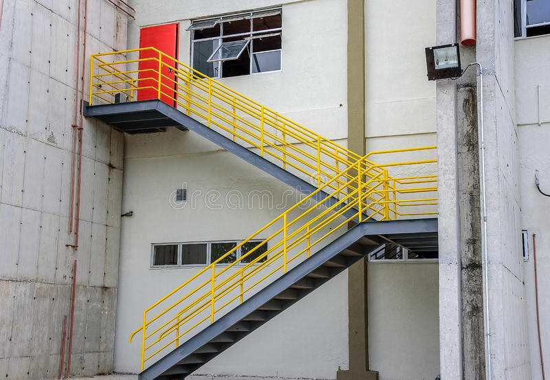 At the cargo terminal in the old Galeao airport, white building, ladder with yellow railing and red door. Rio de Janeiro, Brazil stock photo