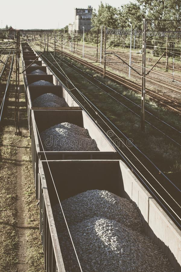 Cargo train with aggregate stones. stock photo
