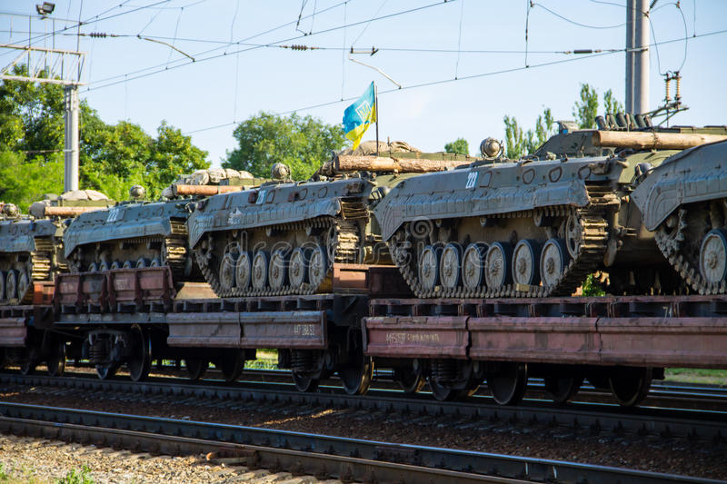 Cargo train carrying military tanks on railway flat wagons. Cargo train carrying military tanks on a railway flat wagons stock photo