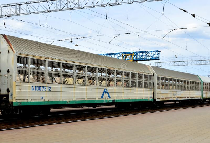 Cargo train with convertible multi-deck automotive wagon. Car-carrying train. Car transportation train. royalty free stock photography